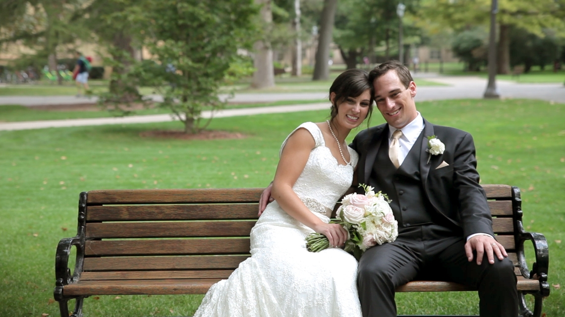 Couple posing on park bench